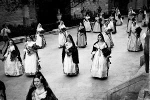 """La Ofernda Women wearing the traditional """"Fallera"""" costume undertake the procession """"La Ofrenda"""""""