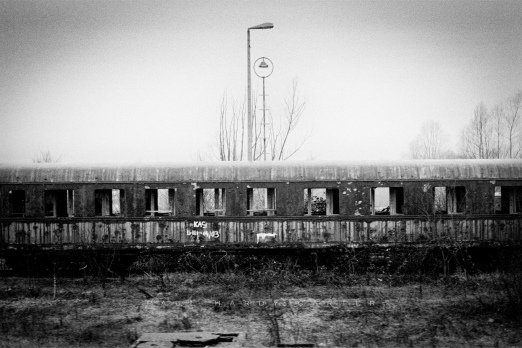 Pictures from a Train Abandoned railway carriage, machine-gunned. Bosnia & Herzegovina 2004