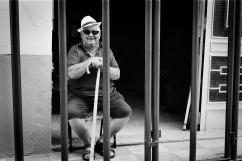 Bous al Carrer Resident of Quatretonda watching the bulls from behind his barricade. Quatretonda, Valencia, Spain. June 2008.