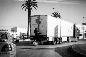 Child Migrnats Tangier Boys attempt to enter the port by riding on the backs of lorries.